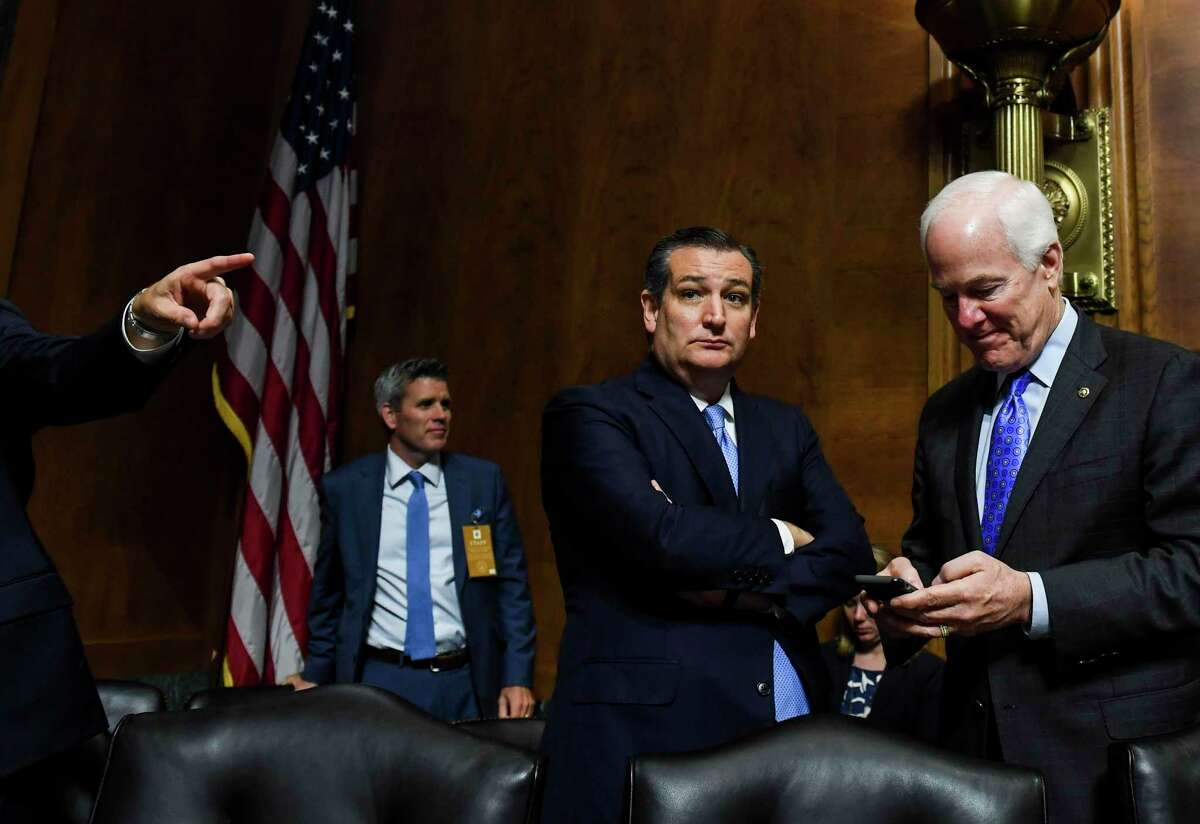 Sens. Ted Cruz and John Cornyn are shown at Capitol Hill in this 2018 photo. The Texas Republicans are at odds over how far the Trump administration should go as the White House weighs restricting guest worker visas amid the coronavirus outbreak.