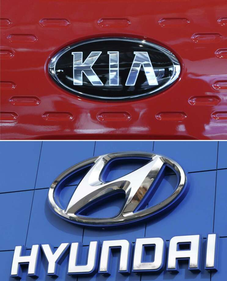 FILE- This combination of file photos shows the logo of Kia Motors during an unveiling ceremony on Dec. 13, 2017, in Seoul, South Korea, top, and Hyundai logo on the side of a showroom on April 15, 2018, in the south Denver suburb of Littleton, Colo., bottom. Hyundai and Kia are recalling more than a half million vehicles in the U.S. because of new problems that can lead to engine fires. Documents posted Thursday, Feb. 28, 2019, by the government show the Korean automakers are adding three recalls after reports of fires across the country. (AP Photo, File) Photo: Associated Press / Copyright 2017 The Associated Press. All rights reserved.