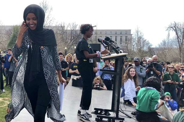 Rep. Ilhan Omar, left, leaves the stage after introducing her daughter, Isra Hirsi, 16, one of the national organizers of last Friday's national Youth Climate Strike.