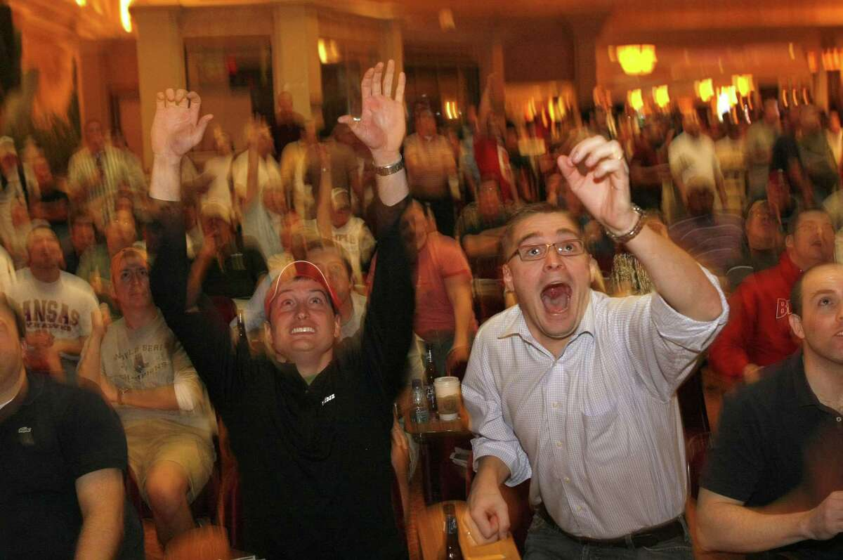 Chris Garofoli, left, of Denver, Co. and C.R. Wooters of Washington DC, celebrate as Xavier comes back to beat Georgia in the first round of the 2008 NCAA basketball tournament. The Sports Book at the Manaday Bay Casino, in Las vegas, Nv., was packed with standing room only as the tournament kicked off today, March 20, 2008. Photo by Michael Macor/ San Francisco Chronicle