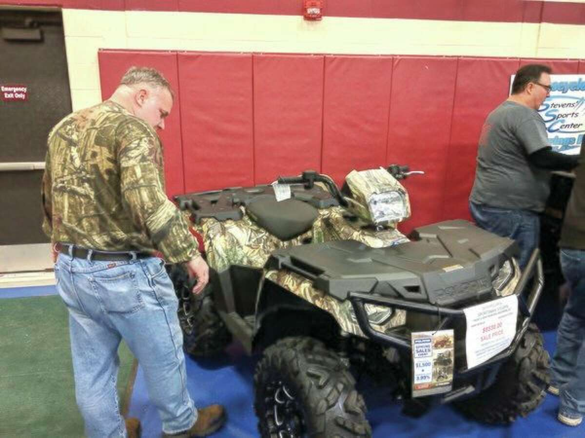 An interested customer looks at one of the many products available during Call of the Wild on Friday night at Greater Midland North Family Center. (Tereasa Nims/For the Daily News)