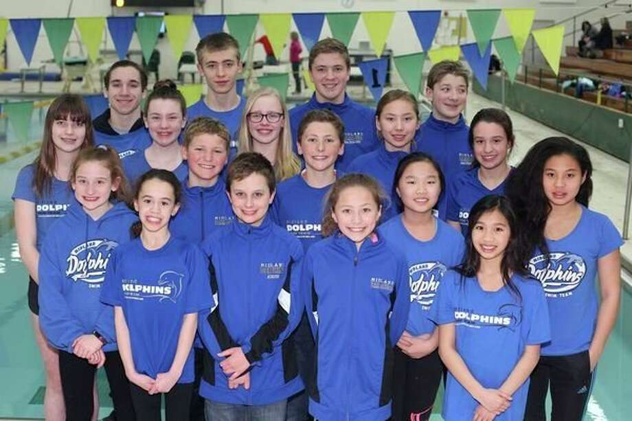 Pictured in the front three rows is the Midland Dolphins' 12-and-under state team: (front row, from left) Avery Johnson, Ransom Kurzer, Vera Roberson, Amy Casipit; (second row, from left) Sammy Thackery, Gabe Soderberg, Eli Soderberg, Kelly Zheng, Alea Casipit; (third row, from left) Eryn Murphy, Emmy Sower, Eleanor Hughes, Ella Roberson, Jordan Johnson. Pictured in the back row is the Dolphins' 13-and-over state team (from left) Nic Courier, Will Gaal, Tyler Bacigalupo, Thomas Bacigalupo.