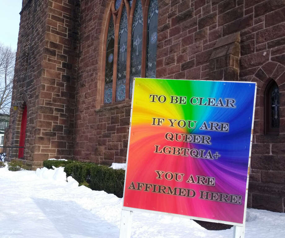 This sign posted in front of Mary Taylor Memorial United Methodist Church in Milford at the end of February went missing, and church officials initially thought it had been stolen. The sign states, 'To be clear if you are queer LGBTQIA+ you are affirmed here.' The sign was later found, and church leadership hopes it was the wind, and not vandals, that removed it. Photo: Jill Dion/ The Milford Mirror