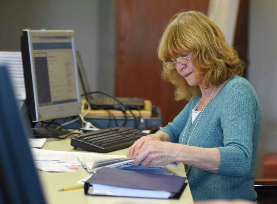 A tax aide helps out a Greenwich resident with her taxes at Town Hall in Greenwich on March 2, 2017. The free tax help program is available from 9 a.m. to 2:30 p.m. Tuesdays, Wednesdays and Thursdays until April 11 in the Hayton Room in Town Hall, and from 9 a.m. to 1 p.m. Saturdays until April 13 at the main Greenwich Library. Photo: Tyler Sizemore / Hearst Connecticut Media / Greenwich Time
