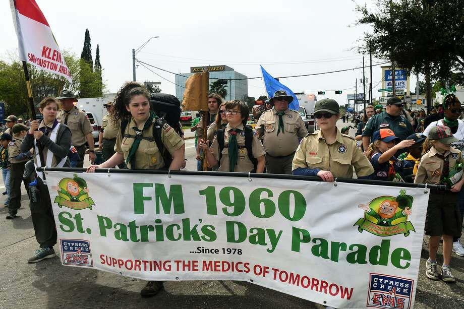 The Baby Axes Patrol of Troop 444 in Houston, led by banner carriers Ava Burre, 12, left, a 7th grader at Doerre Inter., and Meri Satterfield, 14, a freshman at Klein Forest High School, march at the front of the parade. Photo: Jerry Baker, Houston Chronicle / Contributor / Houston Chronicle