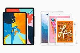 The current iPad line, featuring the debut of the new iPad Air and the iPad Mini.