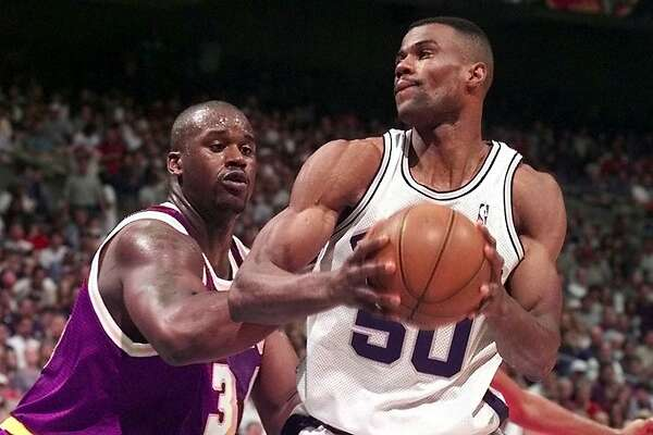 Shaquille O'Neal, left, challenges David Robinson Monday Feb 8, 1999 at the Alamodome in San Antonio, Tex.(Express News Photo/Kevin Geil)