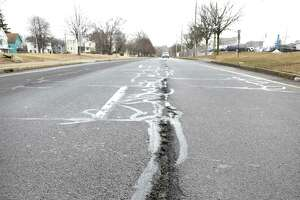 A pothole on North Frontage Road near Tyler Street in New Haven on March 15, 2019.