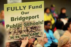 Parent Alissa Gerber along with hundreds of parents came out to tell the city council to fully fund the school board budget request during a committee meeting at City Hall's Council Chambers in Bridgeport, Conn., on Tuesday Apr. 25, 2017. The board wants $11.4 million over what it gets now.