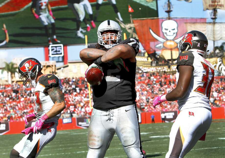 TAMPA, FL - OCTOBER 30: Tackle Donald Penn #72 of the Oakland Raiders stares into the stands after catching a touchdown pass in the third quarter against the Tampa Bay Buccaneers to tie the game at 10-10 at Raymond James Stadium on October 30, 2016 in Tampa, Florida. (Photo by Joseph Garnett Jr. /Getty Images) Photo: Joseph Garnett Jr./Getty Images