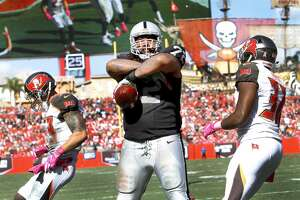 TAMPA, FL - OCTOBER 30: Tackle Donald Penn #72 of the Oakland Raiders stares into the stands after catching a touchdown pass in the third quarter against the Tampa Bay Buccaneers to tie the game at 10-10 at Raymond James Stadium on October 30, 2016 in Tampa, Florida. (Photo by Joseph Garnett Jr. /Getty Images)