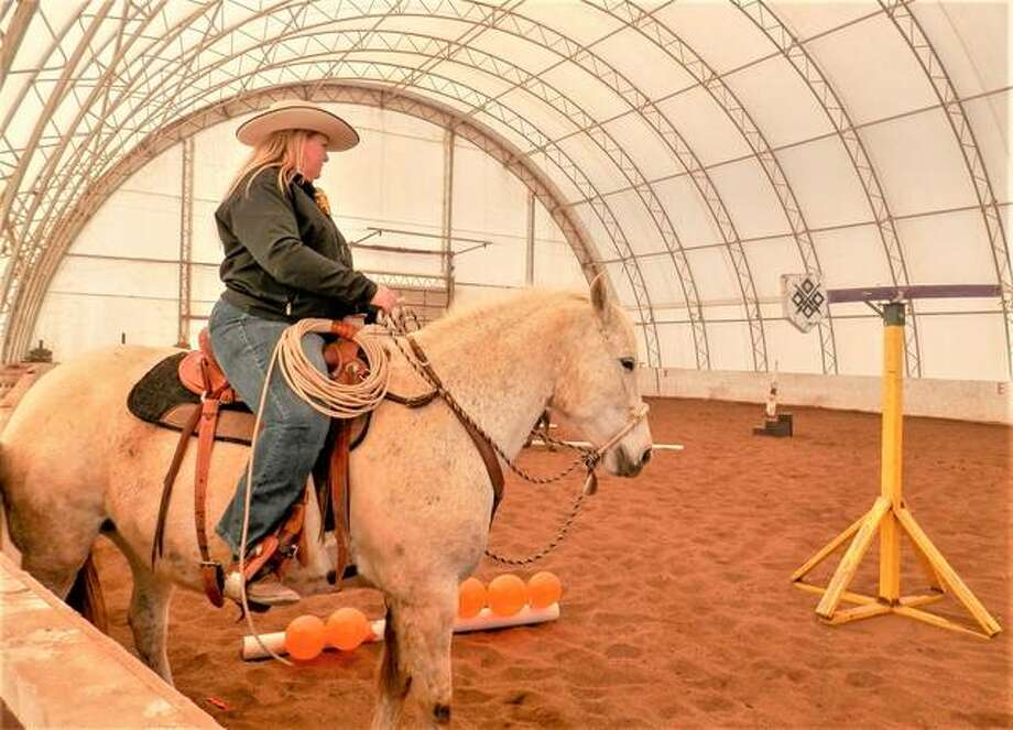 Owner Marcy Heepke rides her horse through an obstacle course at Triangle H Farm Saturday in Edwardsville as the business partners with Extreme Trail Horse Association. Photo: Andrew Malo | For The Intelligencer