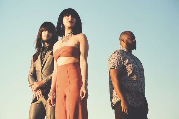 "Texas trio Khruangbin is Laura Lee on bass, Mark Speer on guitar, and Donald ""DJ"" Johnson on drums."
