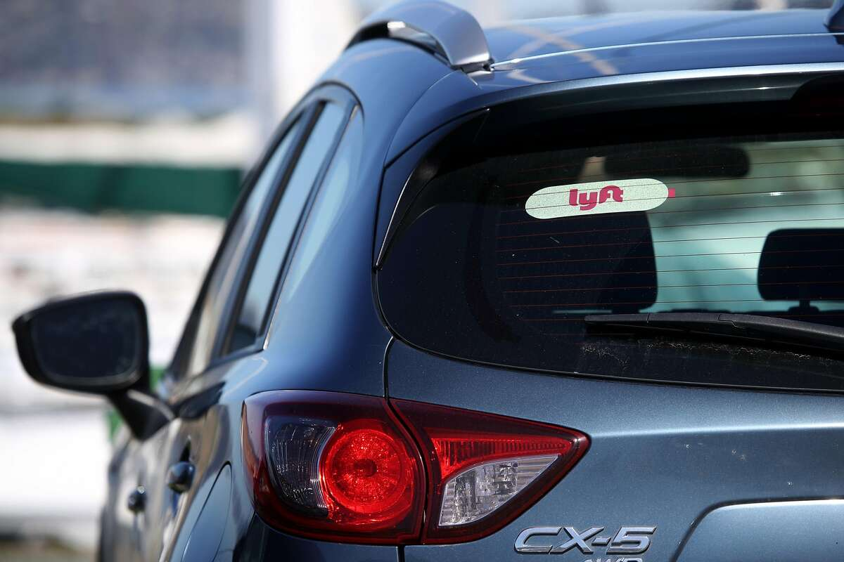 SAN FRANCISCO, CALIFORNIA - MARCH 11: The Lyft logo is displayed on a car on March 11, 2019 in San Francisco, California. On-demand transportation company Lyft has filed paperwork for its initial public offering that is expected to value the company at up to $25 billion. (Photo by Justin Sullivan/Getty Images)