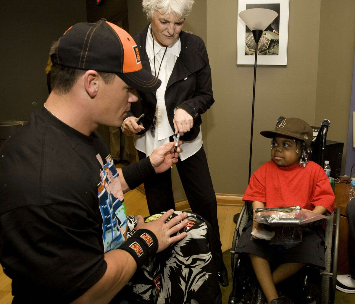 Sue Aitchison and WWE superstar John Cena meet with a Make-A-Wish child in Phoenix in 2008.