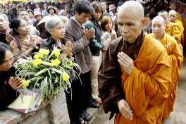 Zen Buddhist monk leader Thich Nhat Hanh prays during a three-day requiem for the souls of Vietnam War victims held 20 April 2007 at a pagoda in Soc Son district, suburban Hanoi. The monk has held two others requiems in Southern and Central Vietnam.