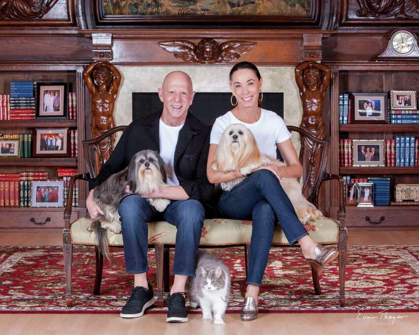 Lester and Sue Smith pose at home with their beloved pets.