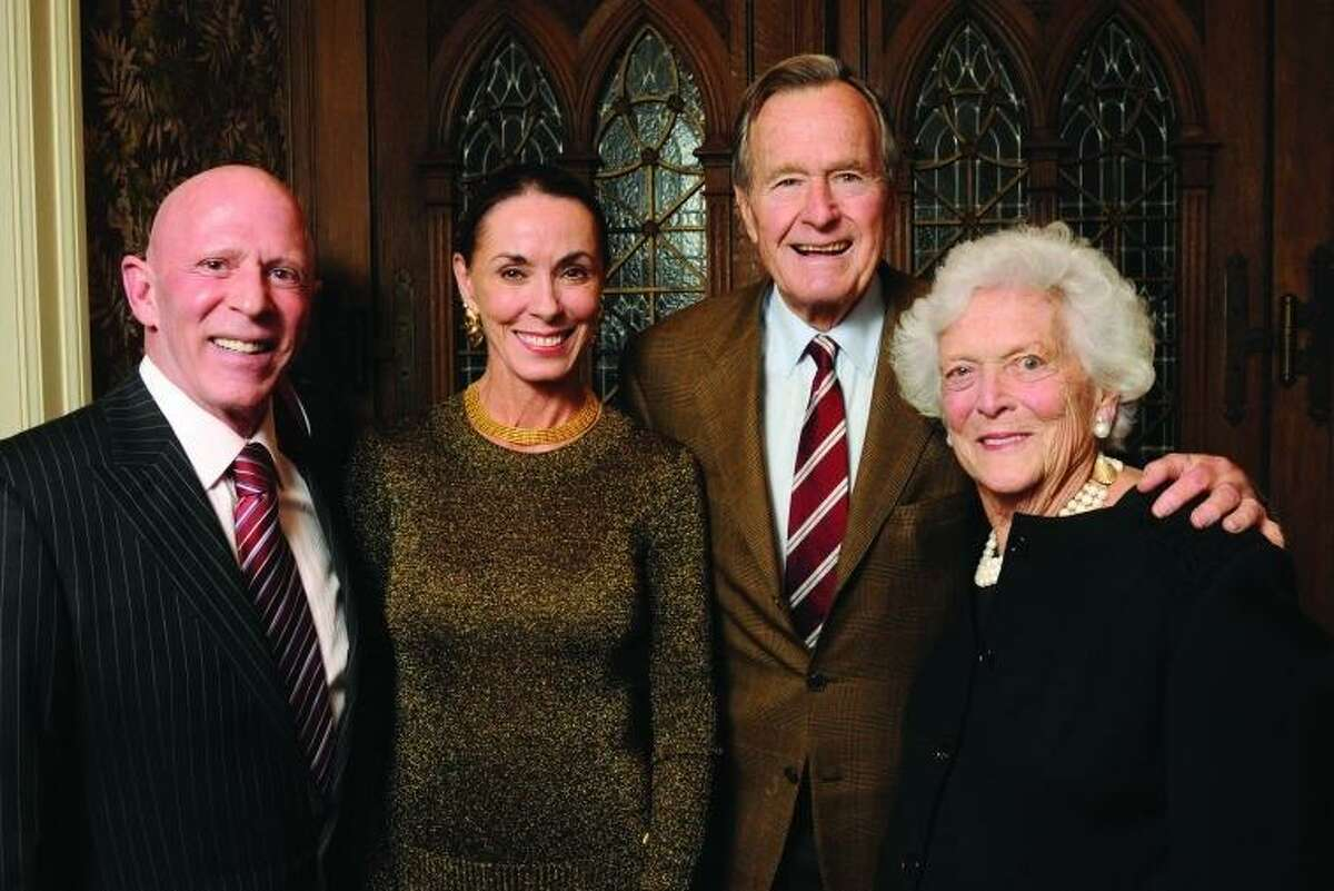 Lester and Sue Smith pictured with former President George H.W. Bush and first lady Barbara Bush