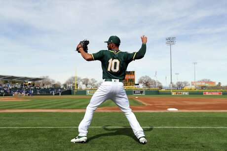 MESA, AZ - FEBRUARY 24: Marcus Semien #10 of the Oakland Athletics warms up prior to a Spring Training game against the Kansas City Royals on Sunday, February 24, 2019 at HoHoKam Stadium in Mesa, Arizona. (Photo by Alex Trautwig/MLB Photos via Getty Images)