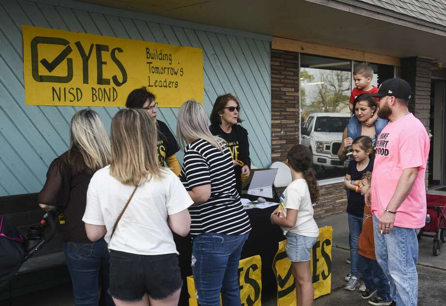 Phyllis Mosley, left, and Suzie Tweedel talk to people at a NISD Bond booth outside of Nederland's Heritage Festival on Tuesday. Photo taken on Tuesday, 03/12/19. Ryan Welch/The Enterprise Photo: Ryan Welch/The Enterprise