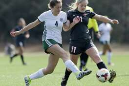 College Park's Sam Curry (4) goes after the ball against Bellaire defenseman Alexandra Couvillon (11) in the first period of a match during the Highlander Invitational at Gosling Sports Complex, Thursday, Jan. 4, 2018, in The Woodlands.