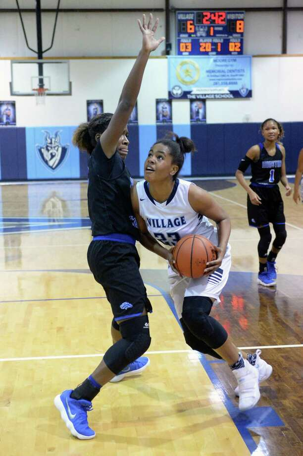 Jada Malone (23) of Village drives to the hoop during the first quarter of a varsity girls basketball game between The Village Vikings and the Houston Christian Mustangs on Friday January 5, 2018 at The Village School, Houston, TX. Photo: Craig Moseley, Staff / Houston Chronicle / ©2018 Houston Chronicle