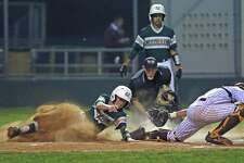 McCollum's Geonie Vasquez beats the tag from Harlandale's Christopher Perez during a game at the Tejeda Complex last season. Vasquez was instrumental in beating Harlandale on March 15; as starting pitcher, Vaquez struck out six and allowed just one hit in five innings in the 7-2 win.