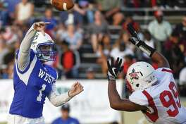 West quarterback Amryn Jeffery (1) throws a pass as East linebacker Yvan Andrew defends during the first half of the Bayou Bowl high school football game, Saturday, June 9, 2018, in Baytown. (Eric Christian Smith/For the Chronicle)