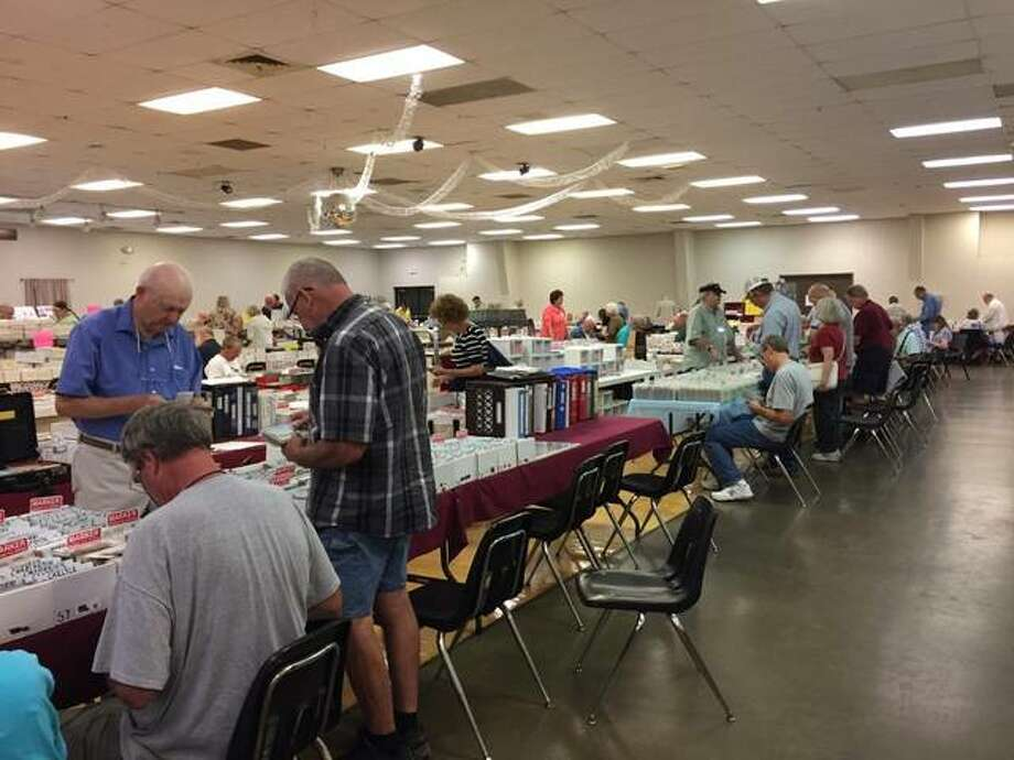 Vendors display their supply of postcards to attendees at a previous Metro East Postcard Show and Sale. Photo: Photo Via Tom Snyder
