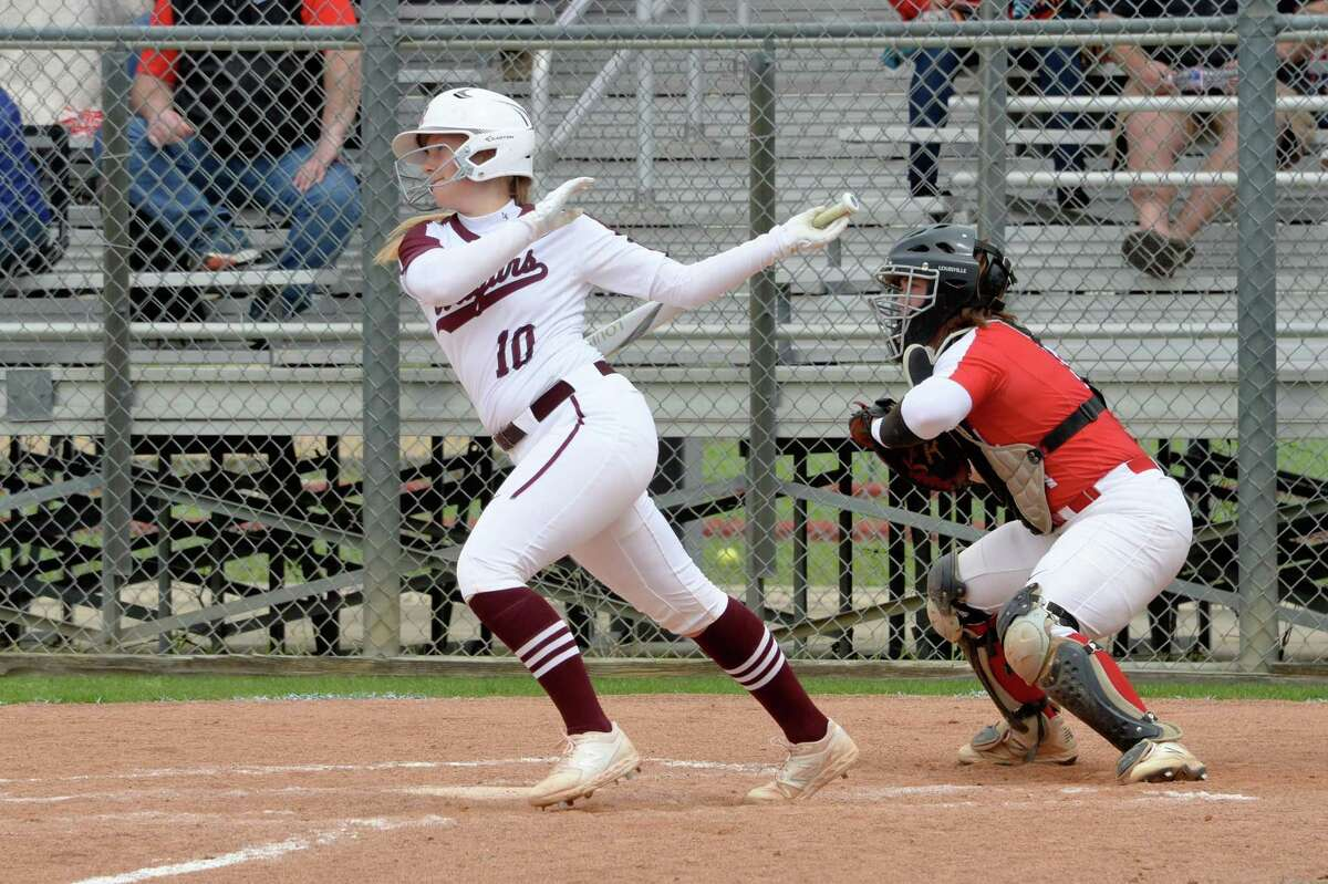 Riley Rutherford (10) of Cinco Ranch doubles during the first inning in high school softball game between the Cinco Ranch Cougars and the Memorial Mustangs on Saturday March 16, 2019 at Cinco Ranch High School, Katy, TX.
