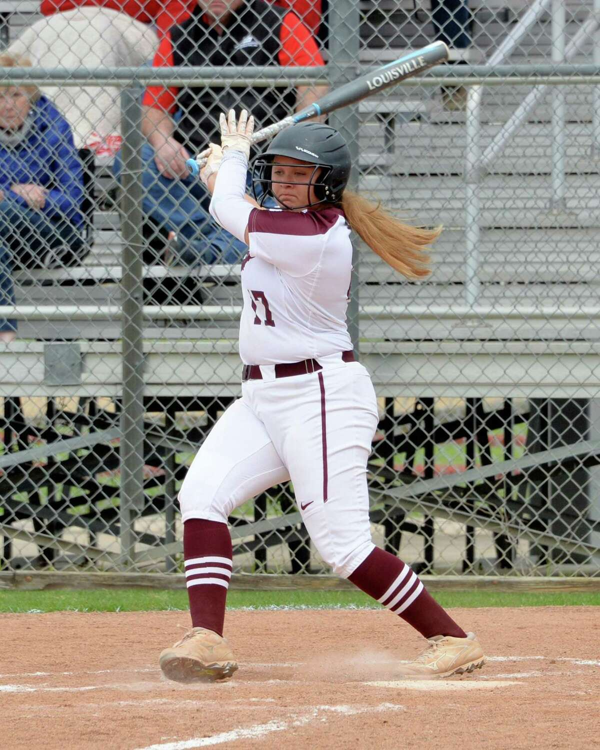Alana Noble (17) of Cinco Ranch singles during the first inning in high school softball game between the Cinco Ranch Cougars and the Memorial Mustangs on Saturday, at Cinco Ranch High School, Katy, TX.