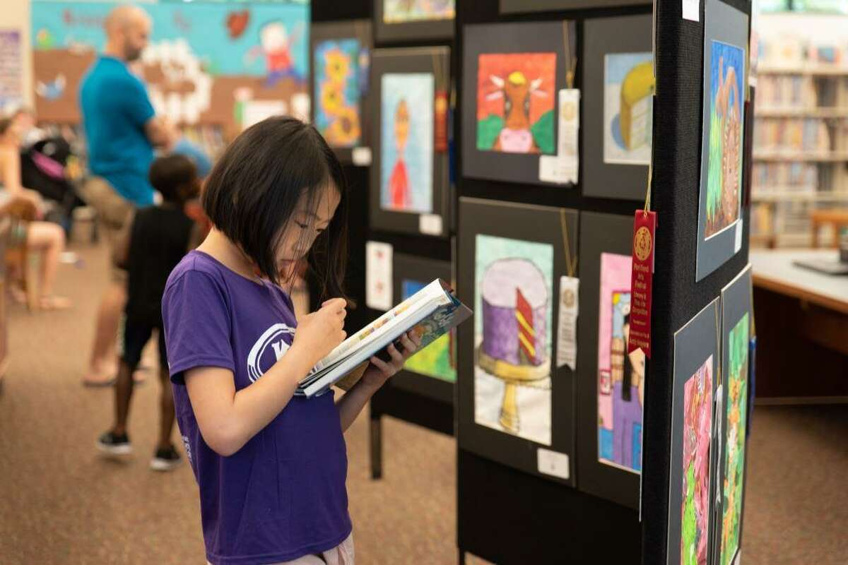 An attendee stops by an exhibit at the Fort Bend Arts Festival.