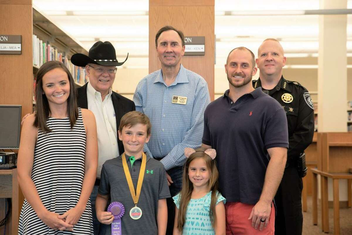 Shown here is the Fort Bend Arts Festival Competition winner with family, Commissioner Andy Meyers, Congressman Pete Olson and Fort Bend County Precinct 3 Constable Wayne Thompson.