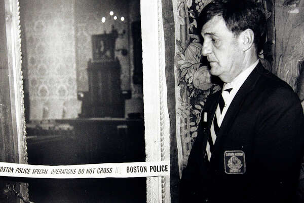 FILE - In this March 21, 1990, file photo, a security guard stands outside the Dutch Room of the Isabella Stewart Gardner Museum, the site where robbers stole treasured art objects in Boston