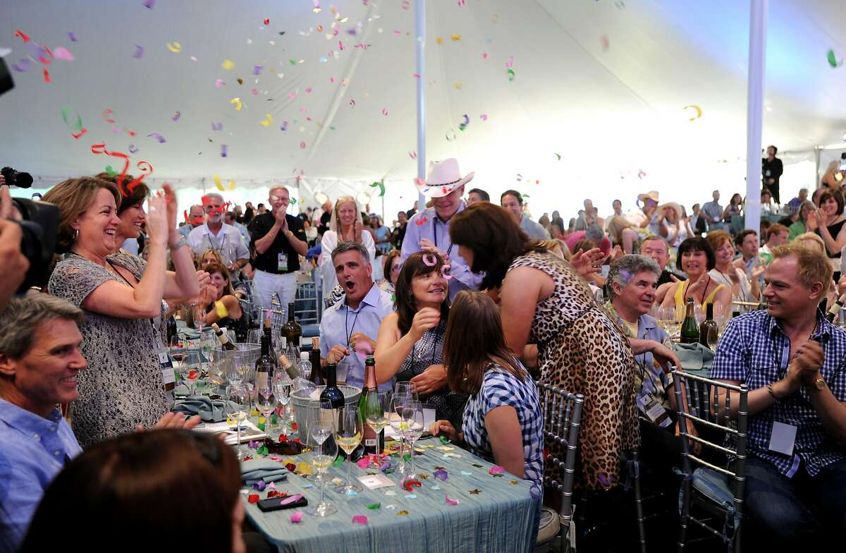 Barbara Banke of Jackson Family Wines celebrates after winning Lot 35 for $460 thousand during Auction Napa Valley 2012 held at Meadowood resort in St. Helena, California. June 2, 2012.
