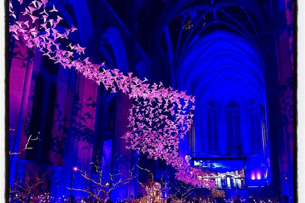 """""""Les Colombes"""" by artist Michael Pendry take flight during Grace Cathedral Carnivale. March 5, 2019."""