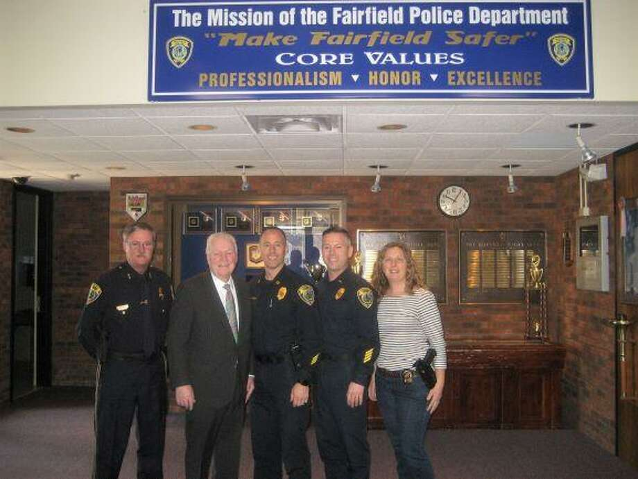 From left,  Police Chief Chris Lyddy, First Selectman Mike Tetreau, Captain Robert Kalamaras, Lieutenant Ed Greene and Detective Belinda Papageorge at Police Headquarters on Reef Road. Photo: Contributed Photo