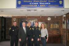 From left,  Police Chief Chris Lyddy, First Selectman Mike Tetreau, Captain Robert Kalamaras, Lieutenant Ed Greene and Detective Belinda Papageorge at Police Headquarters on Reef Road.