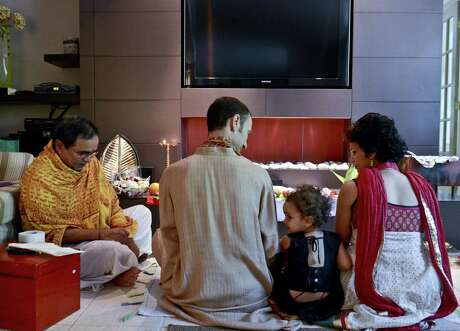 The Hindu ceremony vastu shanti is a blessing of the house and calming of the spirit. It involves a priest, some fire and the homeowners.