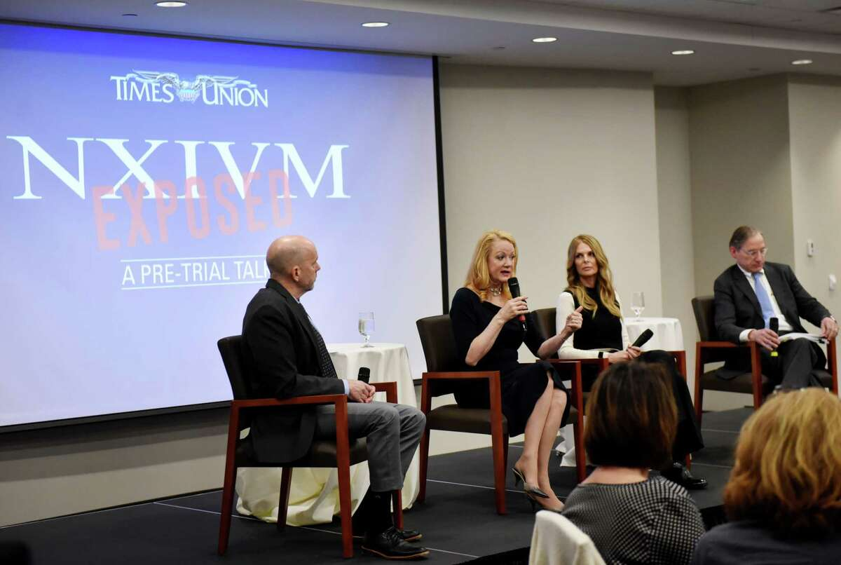 Times Union investigative reporter Brendan Lyons, left, moderates a NXIVM pre-trail talk with Barbara Bouchey, former group member and girlfriend of Keith Raniere, Catherine Oxenberg,