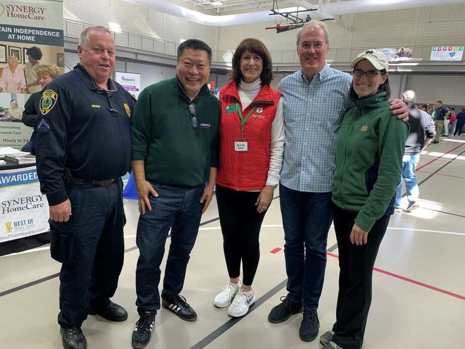 From left, Officer Gary Wickman, Senator Tony Hwang, Executive Director of the Fairfield Chamber of Commerce and event host Beverly Balaz, Event sponsor Jack Collins and state rep Cristin McCarthy Vahey participate in the fifth annual Expo. Photo: Kendra Wingate/ For Hearst Connecticut Media