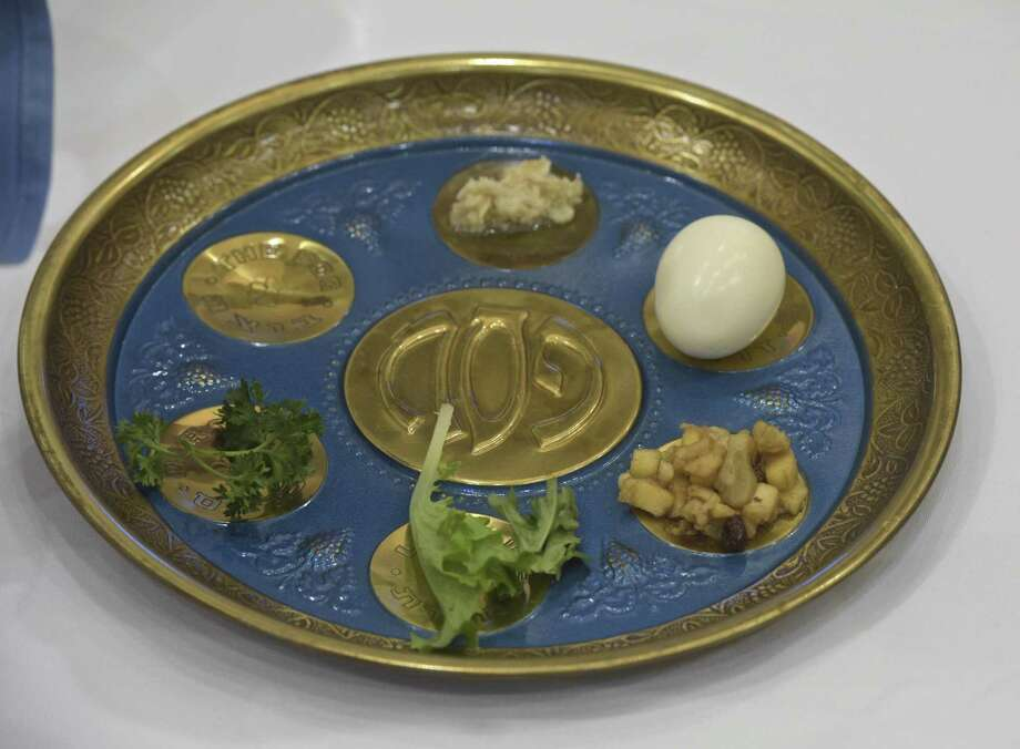 A seder plate consisting of Karpas, Haroset, Maror, Hazeret and a hard boiled egg. During the B'nai Israel passover community seder on Friday night, March 30, 2018, in Southbury, Conn. Photo: H John Voorhees III / Hearst Connecticut Media / The News-Times
