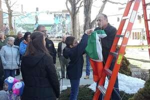 The family of the late Tim Driscoll visited City Hall Monday to honor him as the 2019 Lord Mayor of Torrington, an honor bestowed on Irish Americans from the city. Above, custodian John Lombardi helps raise the Irish flag outside city hall.