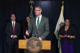Illinois State Treasurer Michael Frerichs discusses legislation he is backing in the General Assembly that would eliminate state-level regulations that prohibit banks and credit unions from serving legitimate cannabis businesses. With him at the news conference Monday in Chicago are (from left) DuPage County State's Attorney Robert Berlin; Democratic state Rep. Kelly Cassidy, of Chicago; and Democratic state Sen. Toi Hutchinson, of Olympia Fields.