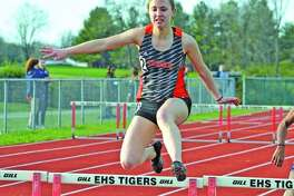 Edwardsville's Elise Krone competes in the 300-meter hurdles during last year's Tiger Invite at the Winston Brown Track and Field Complex.