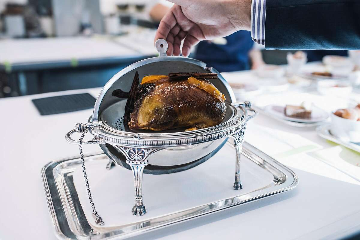 Wild Sonoma watershed Mallard duck with K&J Orchards persimmons, smoked foie gras torchon and sauce bigarade photographed at The French Laundry in Yountville, Calif. on Saturday, Dec. 9, 2017.