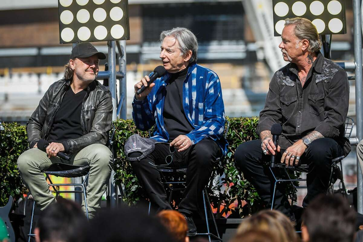 Metallica musicians Lars Ulrich (left), James Hetfield (right), and the SF Symphony music director Michael Tilson Thomas (center) speak on stage after it was announced that they would be the first performers at the Chase Center in San Francisco, Calif., on Monday March 18, 2019.