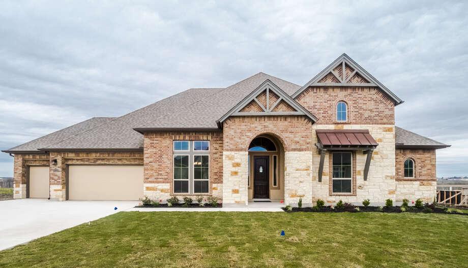 Builder:Texas Homes Communities:Chandler Crossing Address: 6419 Stearin Way, SAT 78109 Price: $496,750 Photo: Texas Homes