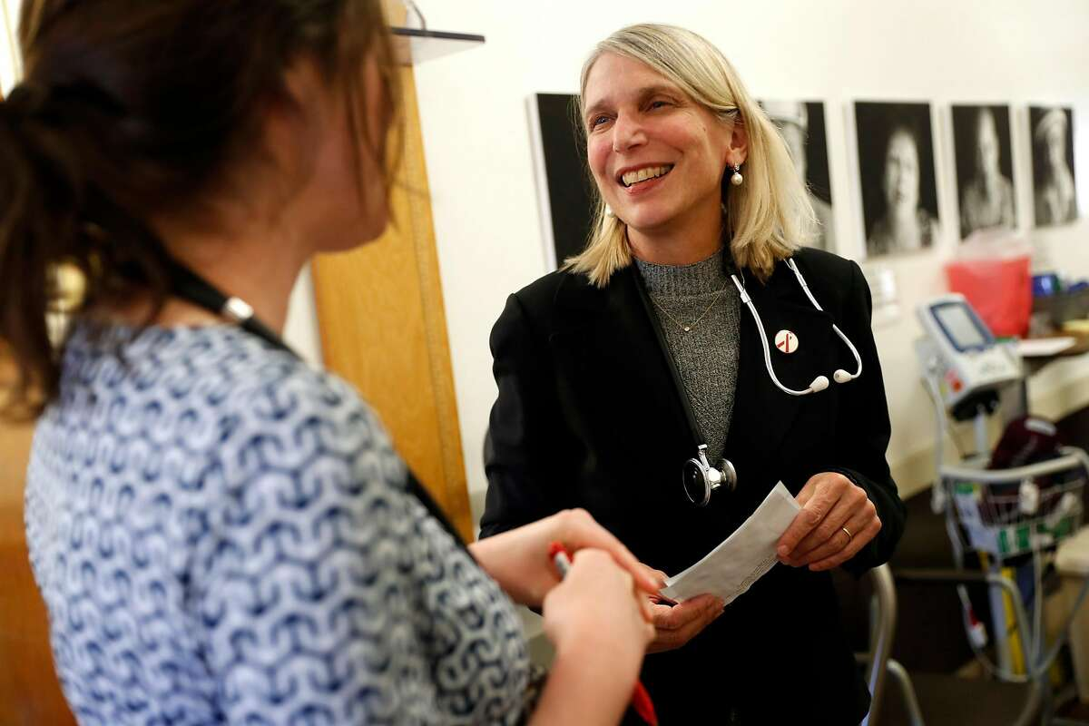 Dr. Diane Havlir (right) and Dr. Elizabeth Imbert chat at San Francisco General Hospital's HIV/AIDS clinic in San Francisco, Calif., on Thursday, March 14, 2019.