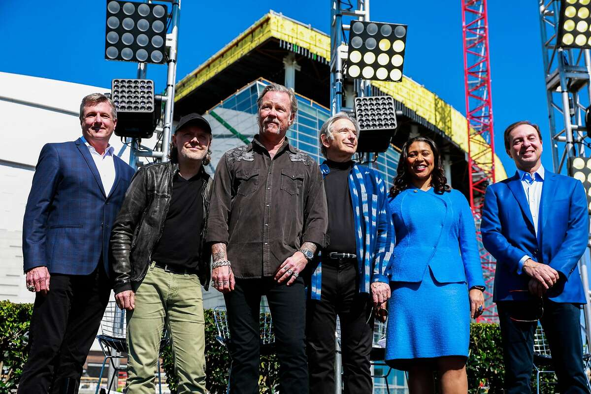 Warriors president and COO Rick Welts (left) poses with Metallica musicians Lars Ulrich, James Hetfield, the SF Symphony music director Michael Tilson Thomas, Mayor London Breed and Golden State Warriors owner Joe Lacob after announcing them as the first performer at the Chase Center in San Francisco, Calif., on Monday March 18, 2019.